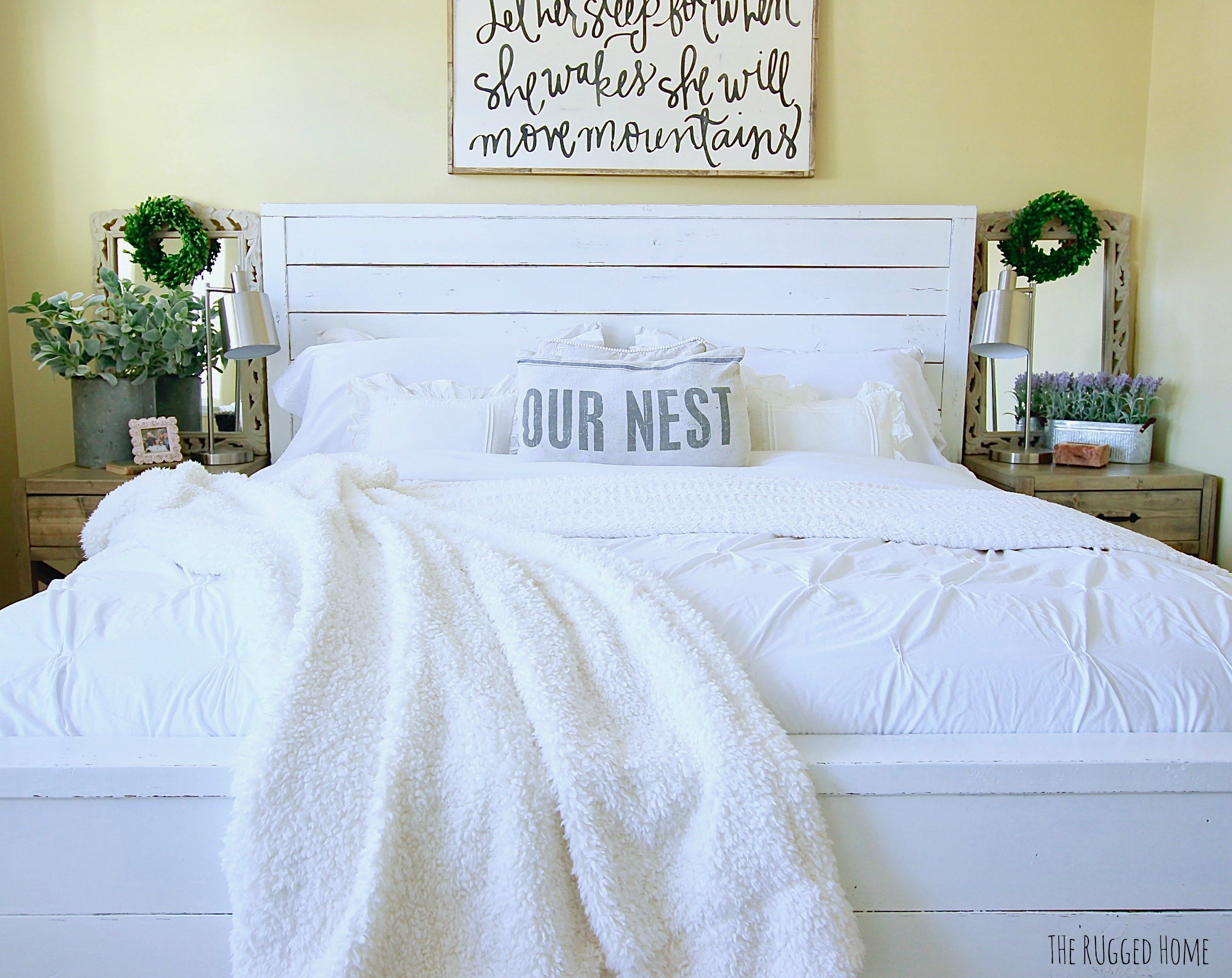 Slowly starting to decorate our farmhouse bedroom. Fixer Upper Style bed, distressed cursive picture and sage plants to the mix www.whitepicketfarmhouse.com