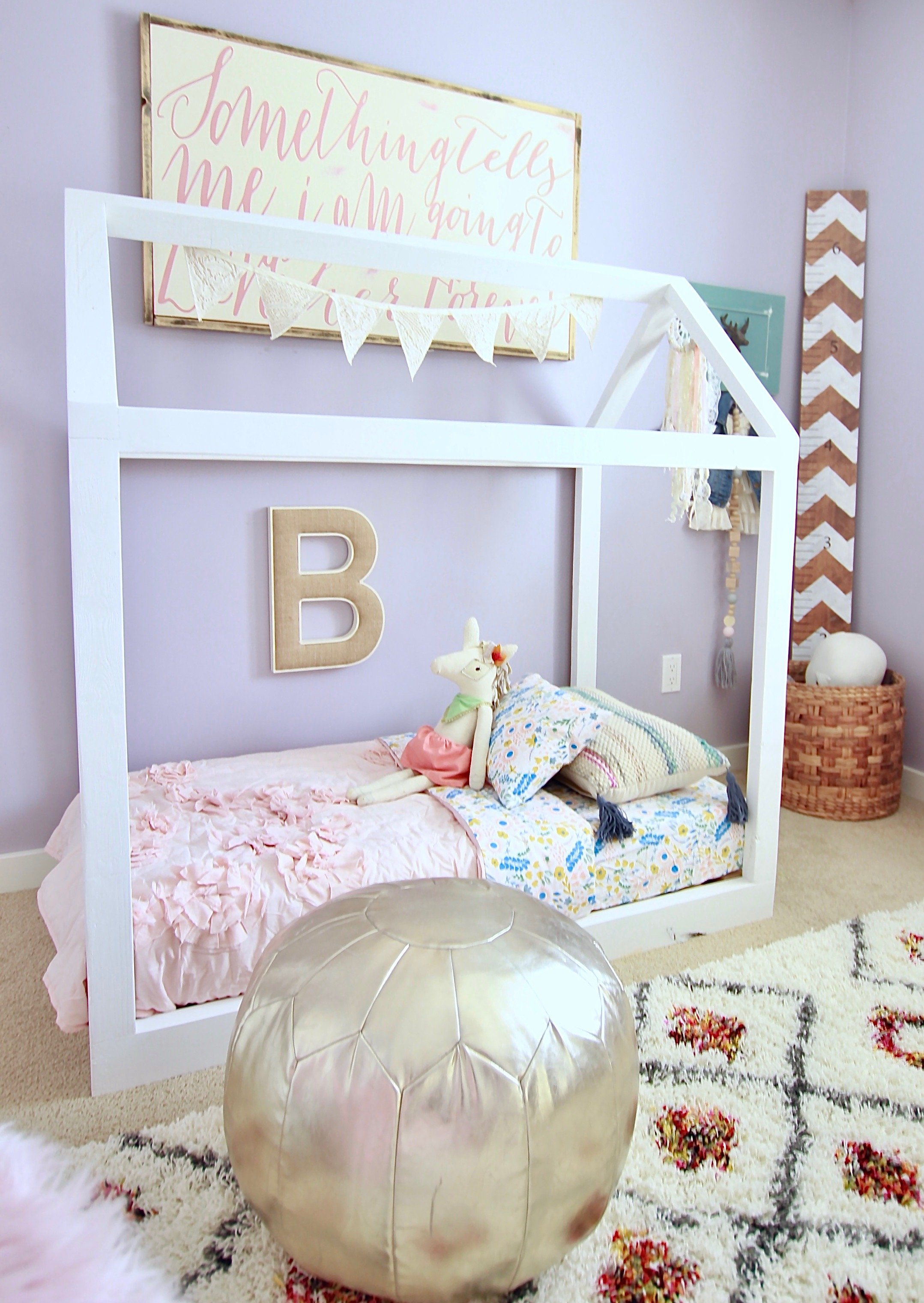 Our Super Easy DIY Toddler House Bed. This bed took under 2 hours and 40 dollars to make. www.whitepicketfarmhouse.com