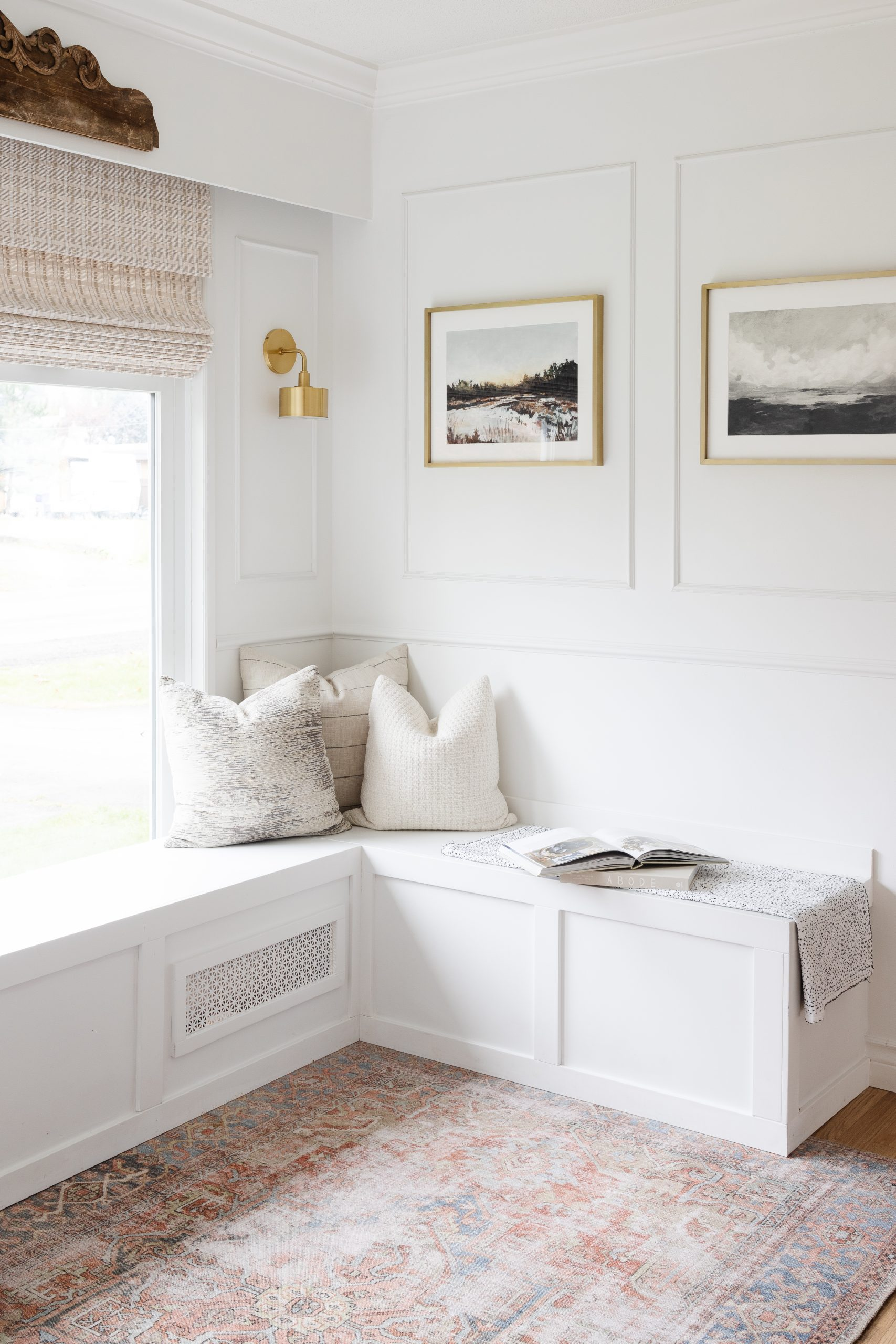 The Easiest and Quickest DIY Chair Rail and Picture Frame Moulding. How we did our dining room for under 100 dollars and how we styled it. Our beautiful DIY Dining Nook with Built In white seating.