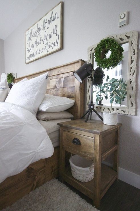 Farmhouse Bedroom with Rustic bed and side table