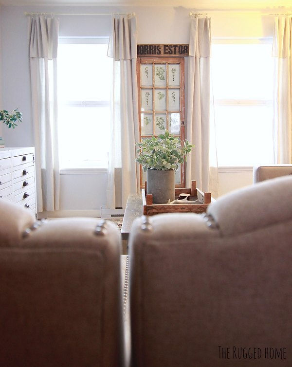 We painted our living room light grey, that it looks almost white. It looks amazing with my farmhouse decor www.whitepicketfarmhouse.com