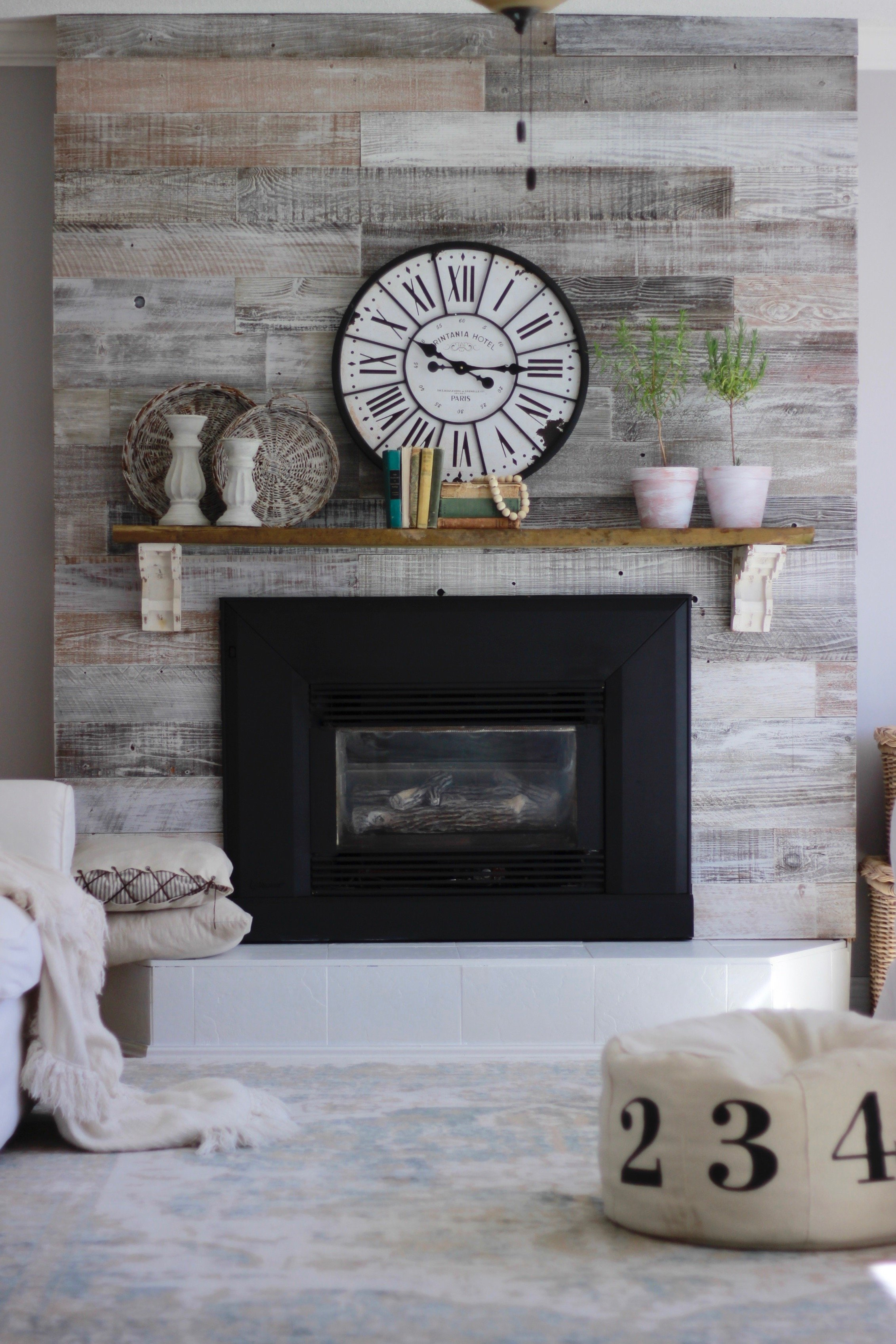 Fireplace Makeover With Plank and Mill. Super Easy Fireplace and Mantle DIY, We painted the tile on the fireplace and used Plank and MillReclaimed Wood to revamp the fireplace. Easy DIY Fireplace, Easy DIY Painted Tile, How To Paint Tile On Fireplace www.whitepicketfarmhouse.com #PaintedTile #fireplacemakeover #DIYFireplace