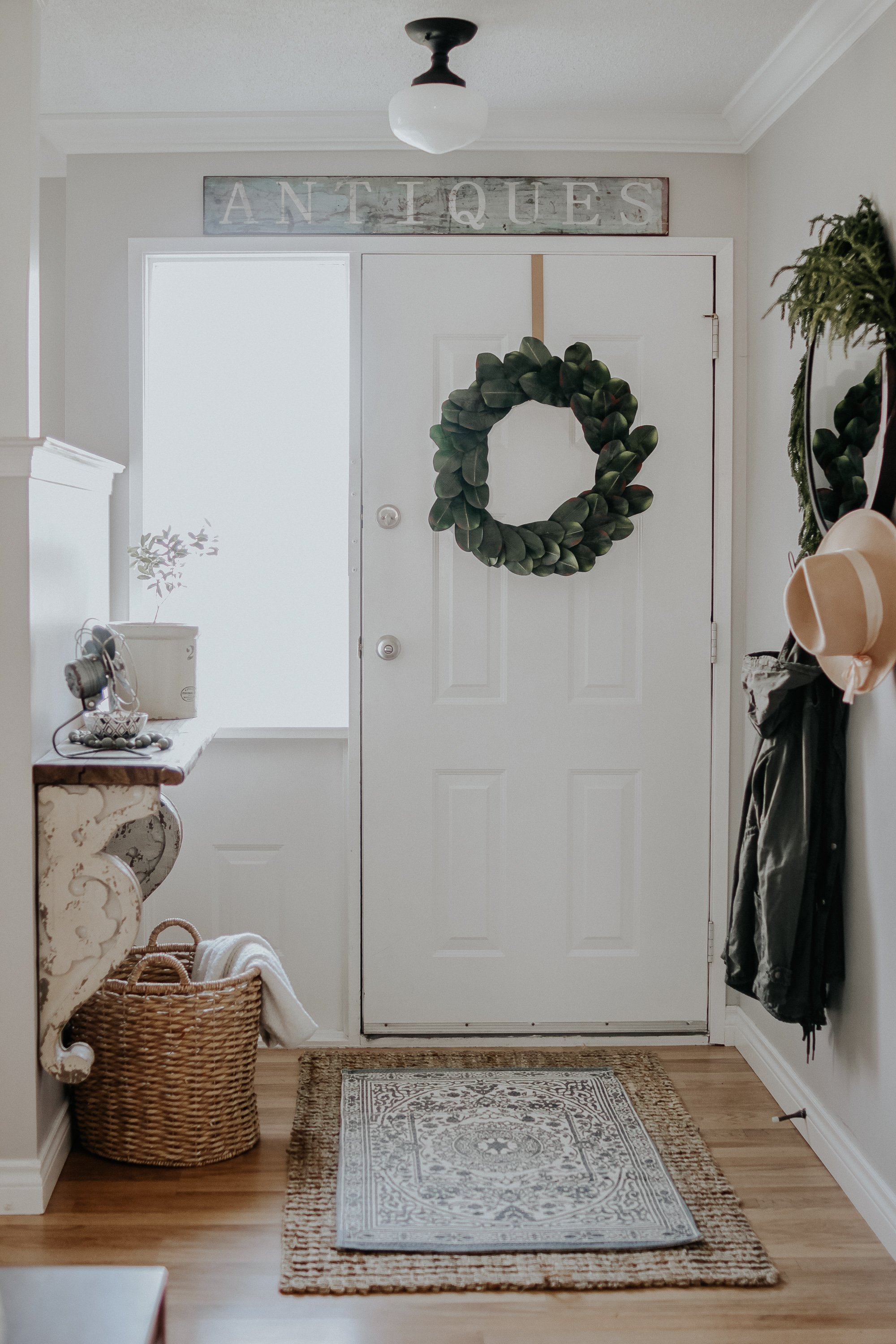 How To Decorate A Small Entrance with limited money and space. How I decorated our little entrance way in our small rancher for free. Key Factors to make your entrance way beautiful and inviting.