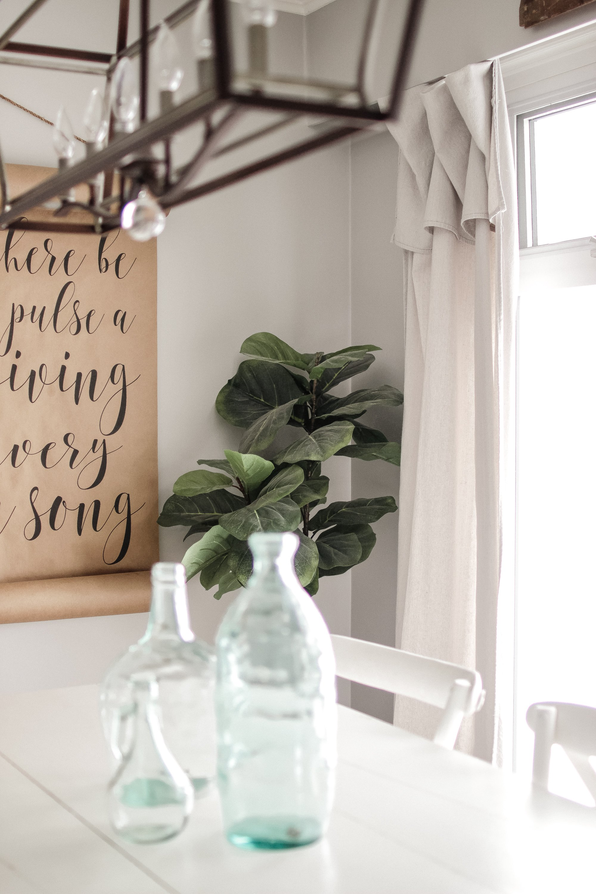 The Easiest DIY Drop Sheet Curtains. You do not need to measure, cut or sew. Super Easy Farmhouse Curtains in Minutes!