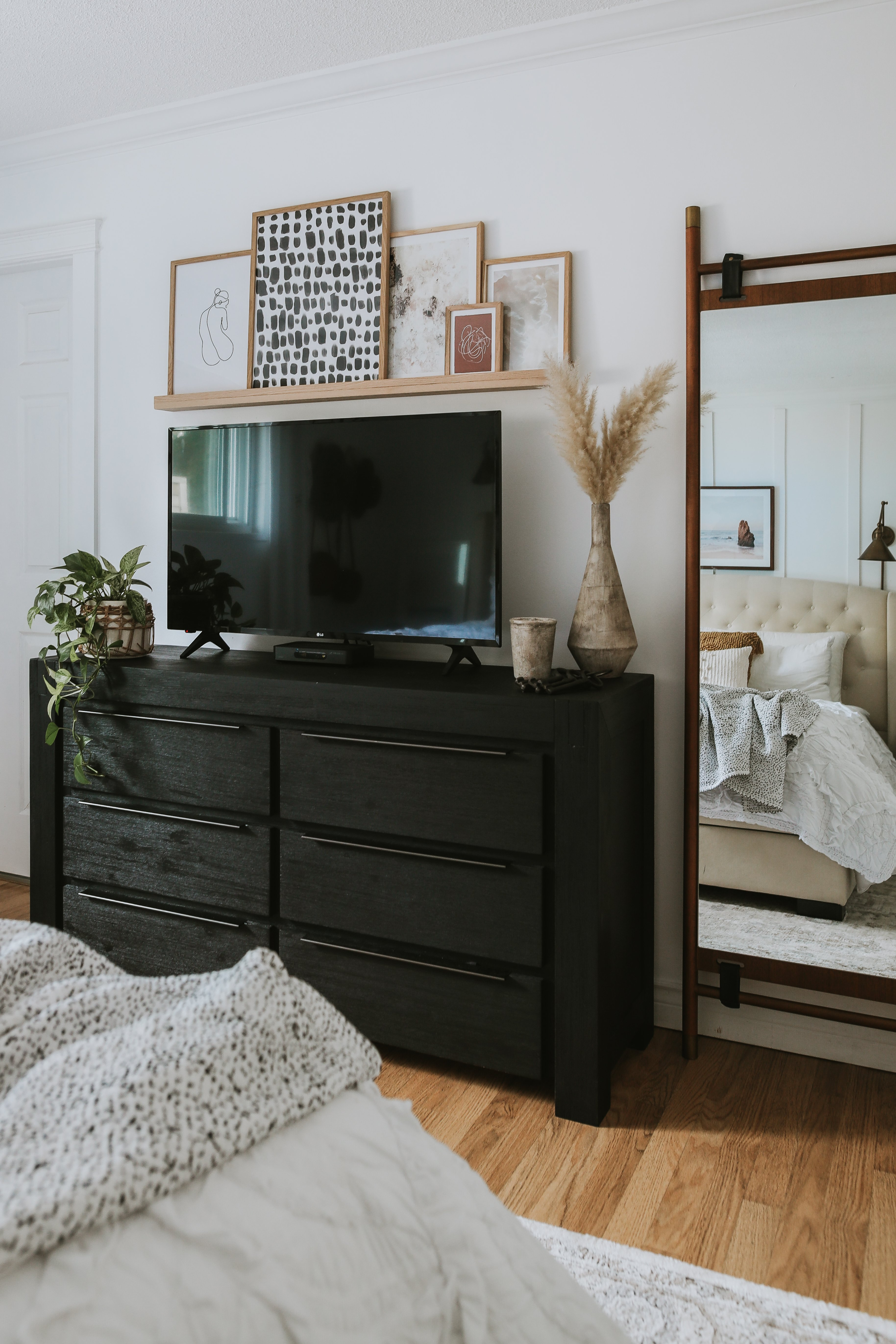How To Decorate Around a TV. How I decorated around our TV while still shopping my house and not spending any money. Two different options to decorate around your TV.