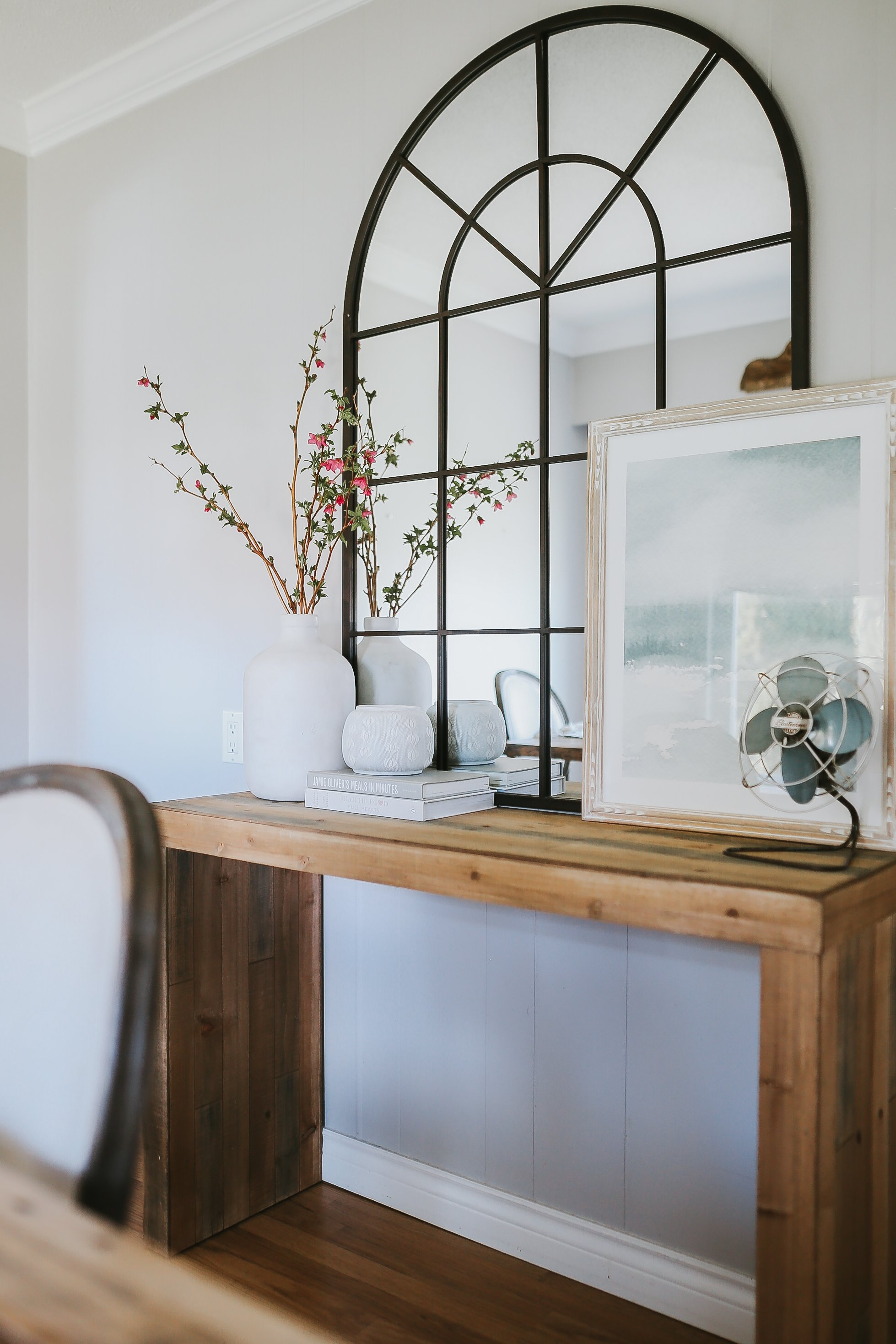 How To Style A Sofa Table. Six steps to style your sofa table effortlessly with items you already have in your own and a few design rules to help you along the way. Here's how I styled my modern electic farmhouse.