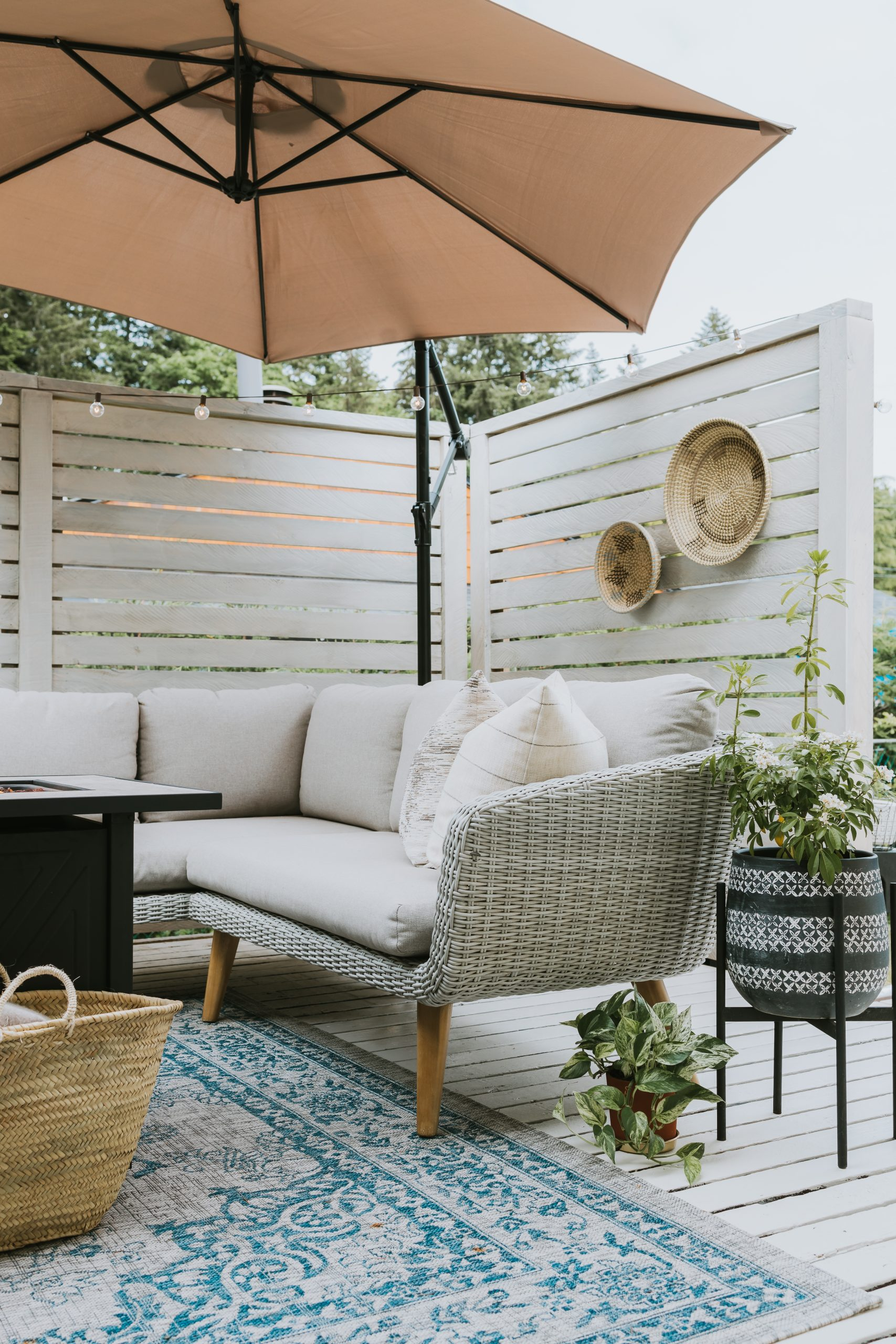 Deck Makeover Part Two. We Stained Our Privacy Panels White Navaho from Behr. Modern Minimal Deck For Summer and how we did it under 50 dollars!