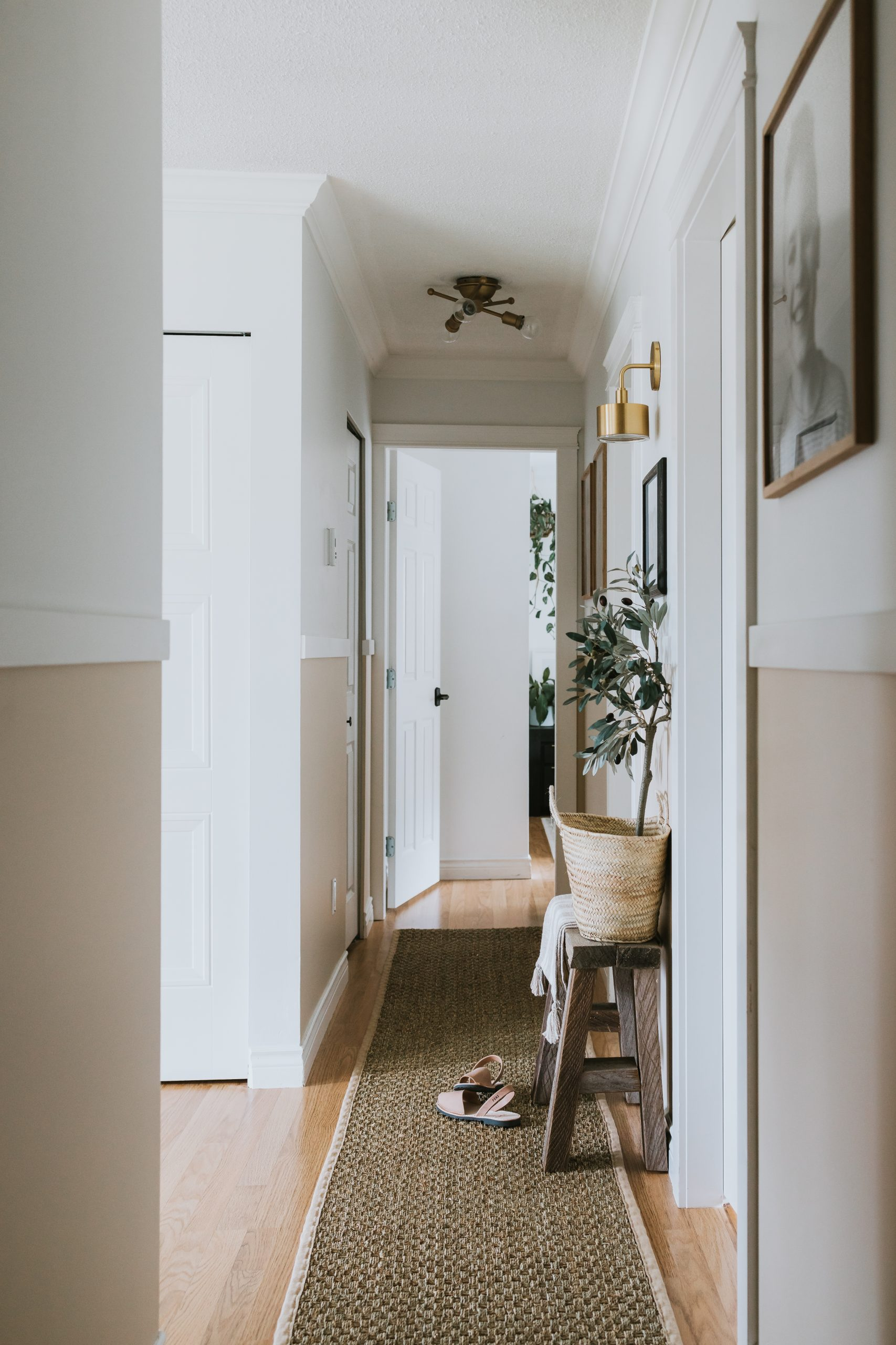 Modern Narrow Hallway Makeover. How TO Transform a dark narrow hallway with no windows into a upscale and modern space with little money and time.