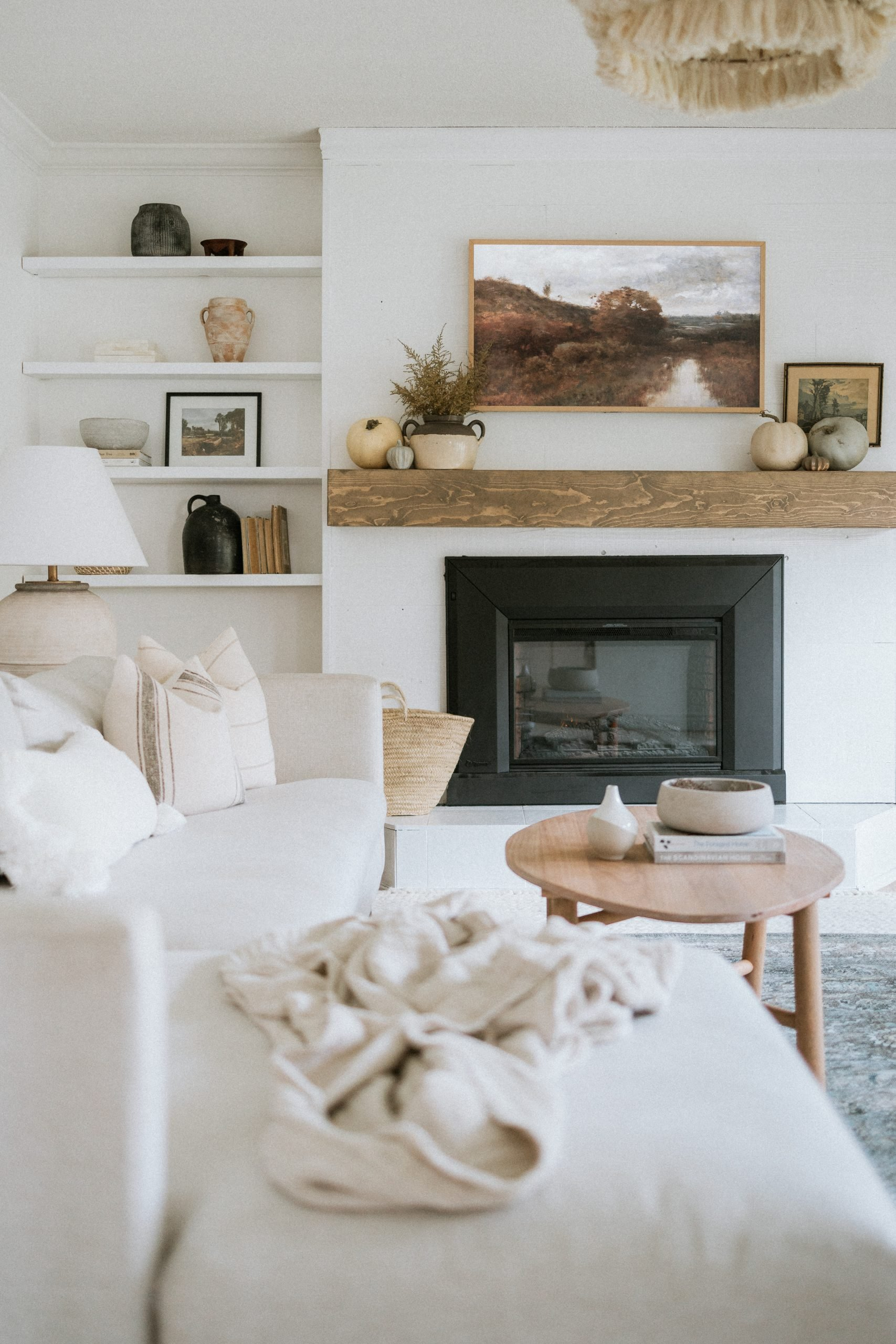 Simple Fall Mantle. For Those That Like Minimal and Cheap Decor, This Blog is For You. I have The Sources Where I found The Pumpkins and Decor as Well As The Art On The TV. Minimal Fall Mantle Decor