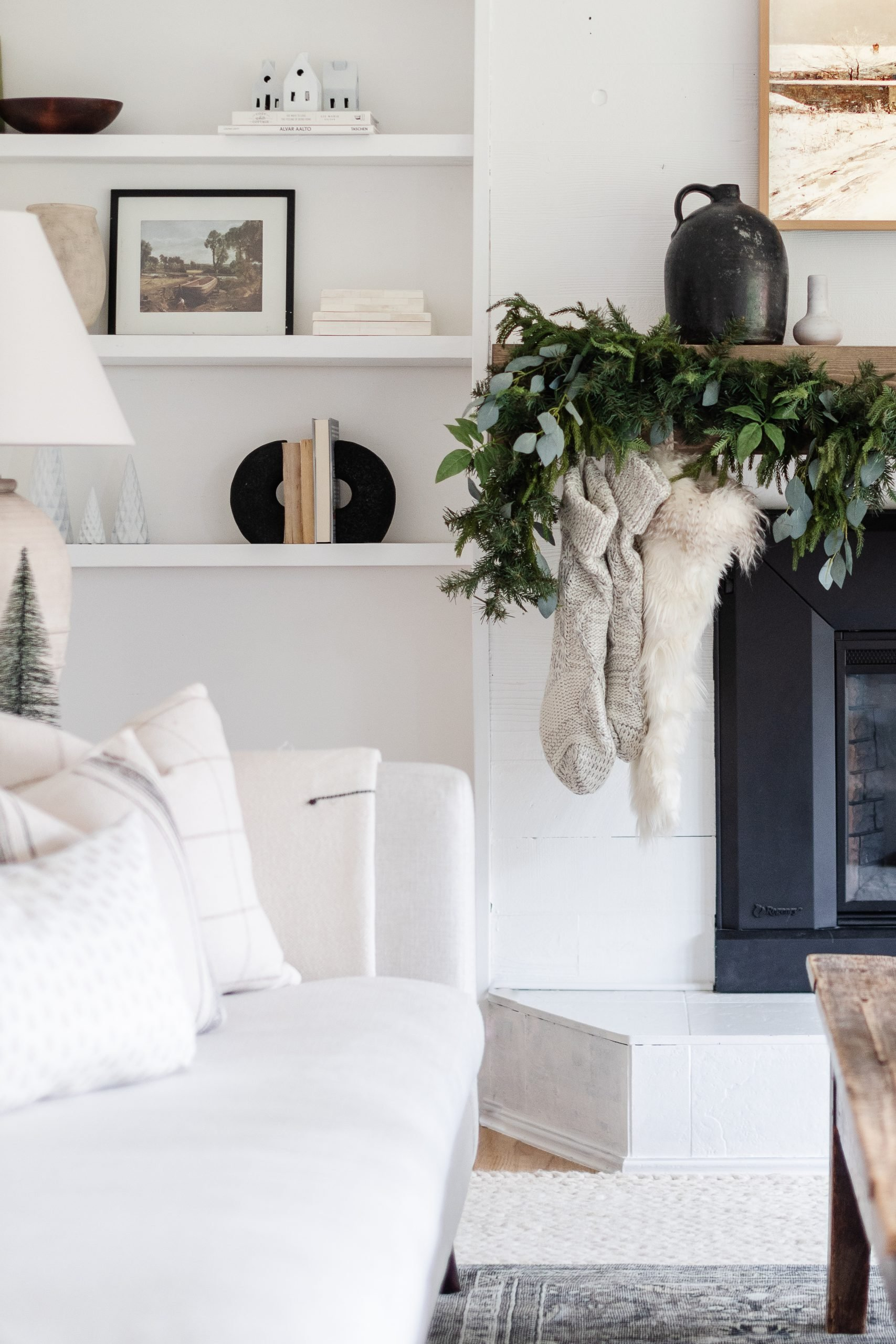 Five Tips Decorate A Christmas Mantle WIth Faux Garlands. A beautiful Holiday Mantle doesn't have to be expensive. Here are my five tips to help you decorate your own mantle this Christmas Season. Check Out My Modern Vintage Christmas Mantle Decorated with Pine and Eucalyptus.