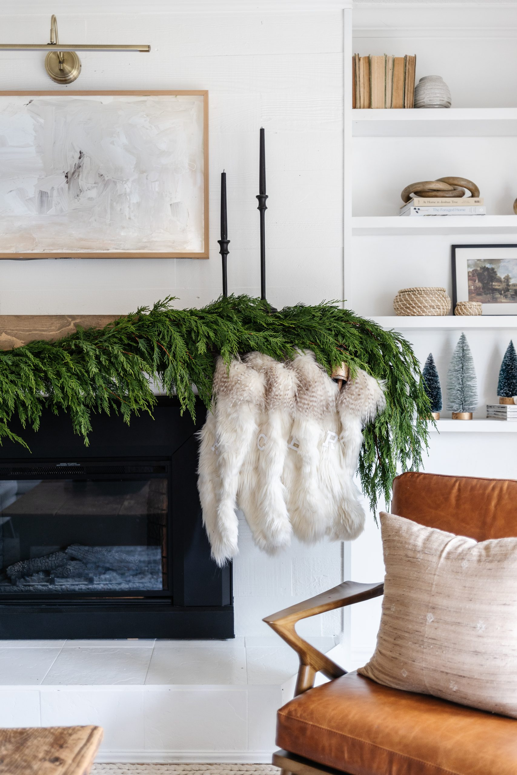 How To Make Your Own Real Christmas Garland and How To Attach It To Your Mantle! What kind of greenery we used and where you can find greenery if you don't have any accessible.